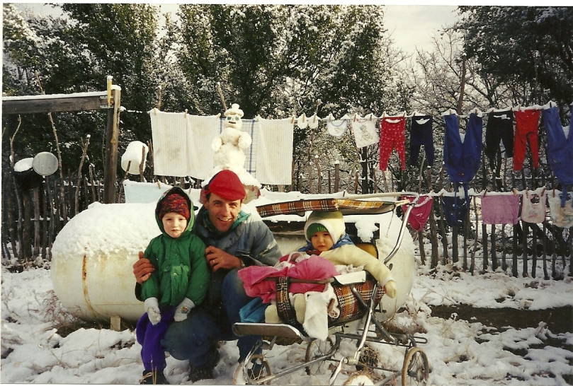 Family with laundry in snow Texas 1999